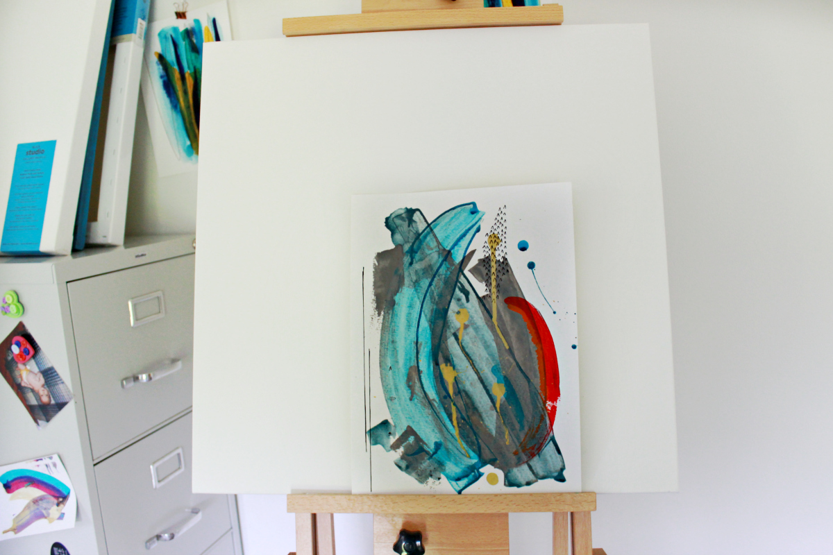 turquoise and red abstract on easel