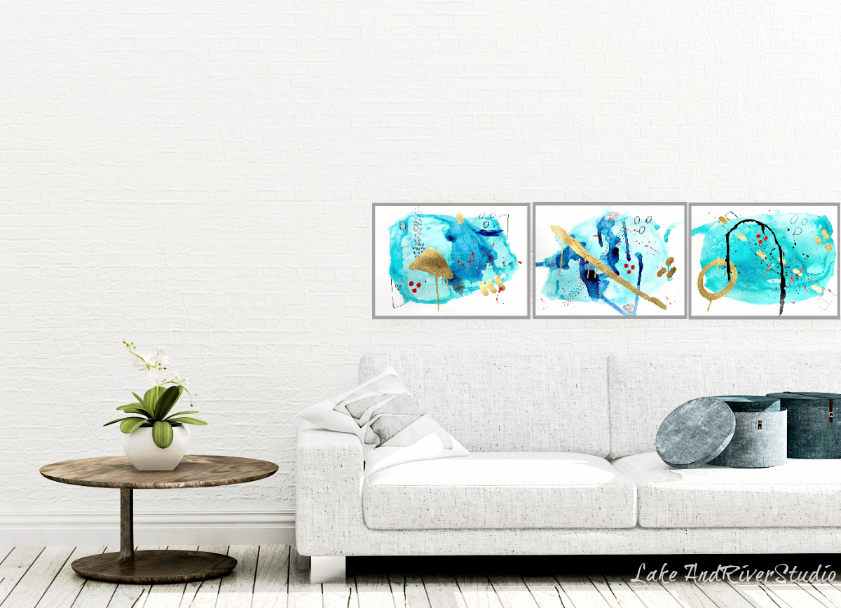 blue abstract art trio over sofa